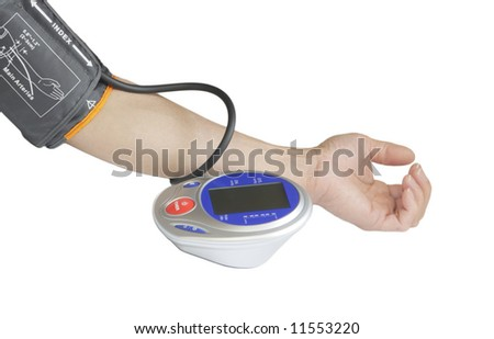 Digital blood pressure monitor on a male's arm isolated on white background for heath care concept