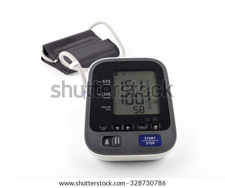 Digital Blood Pressure Monitor on bright background. Hypertension concept.