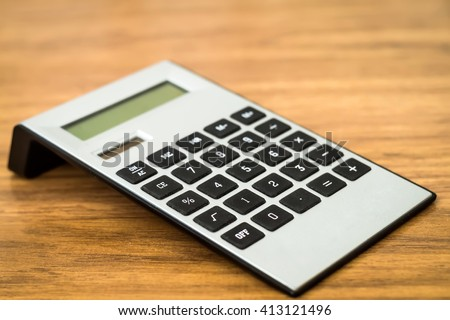 Digital calculator on table.close-up, selective focus with shallow depth of field - stock photo