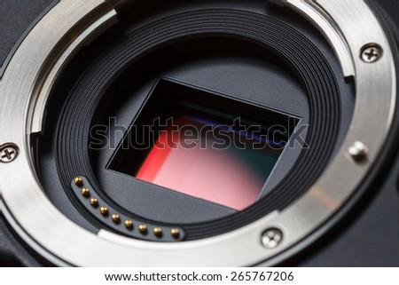 Digital Camera APS-C Sensor and lens mount close-up - stock photo