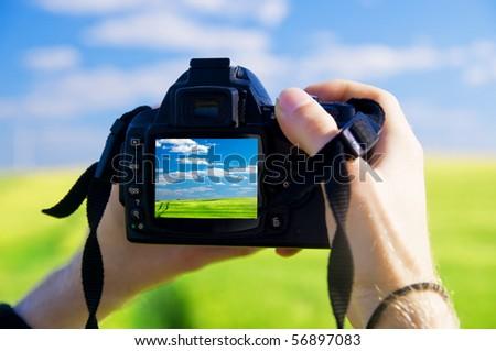 Digital camera capturing beautiful landscape - stock photo