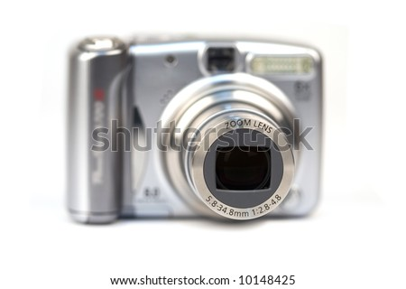 Digital camera close up. Focus on front of lens.