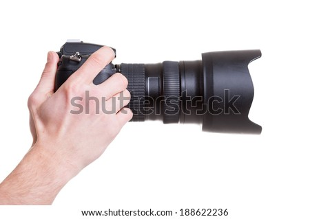 Digital camera. Side view of man holding digital camera while isolated on white - stock photo