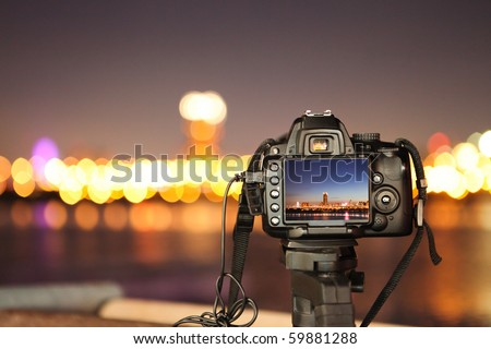Digital camera the night view of city - stock photo