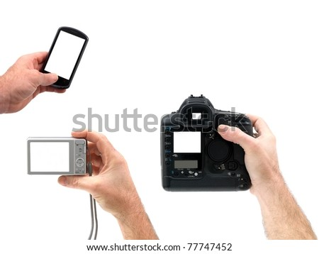 Digital cameras hand held isolated against a white background