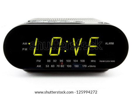 Digital Clock Radio displaying the word LOVE - stock photo