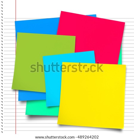 Digital composite image of green adhesive paper against spiral notepad