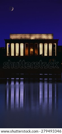 Digital composite: Lincoln Memorial at dusk with crescent moon rising