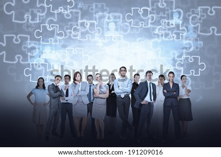 Digital composite of business team against jigsaw background - stock photo