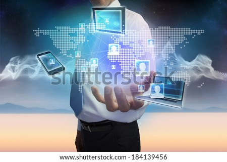 Digital composite of businessman presenting earth interface with connecting devices