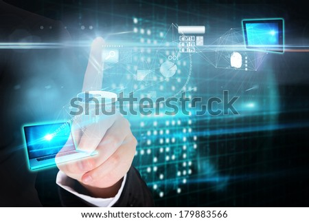 Digital composite of finger pointing to data interface