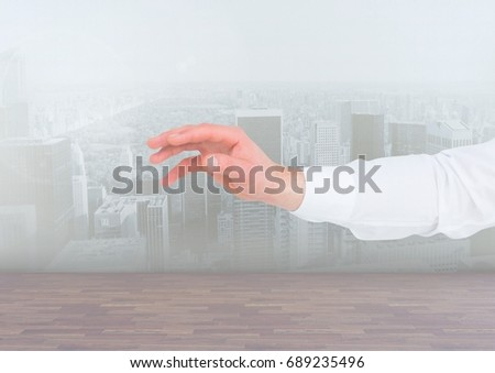 Digital composite of Hands reaching over city