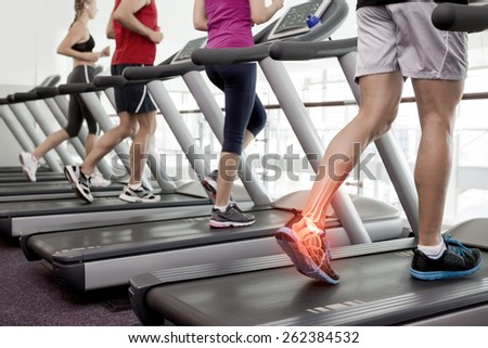 Digital composite of Highlighted ankle of man on treadmill - stock photo