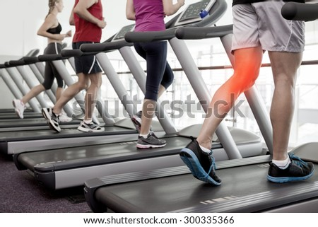 Digital composite of Highlighted knee of man on treadmill - stock photo