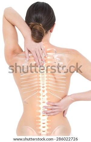 Digital composite of Highlighted spine of woman with back pain - stock photo
