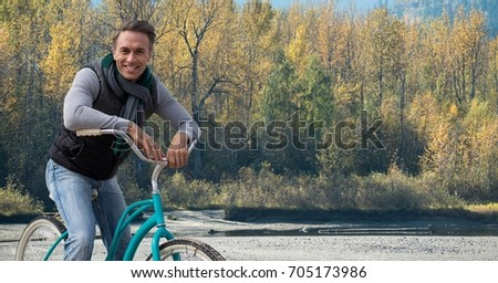 Digital composite of Middle aged man on bicycle against forest
