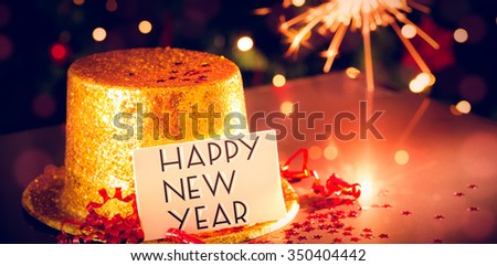 Digital composite of Table at new years eve celebration - stock photo