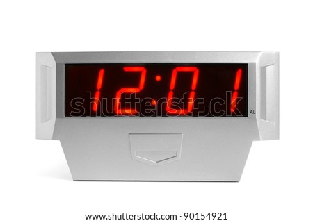 Digital electronic clock on a white background - stock photo