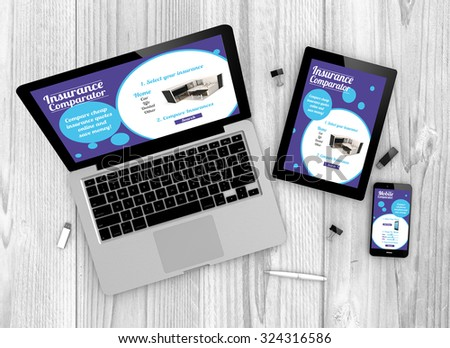 Digital generated devices over a wooden table. laptop, tablet and white smartphone with made up comparator websites interface. - stock photo