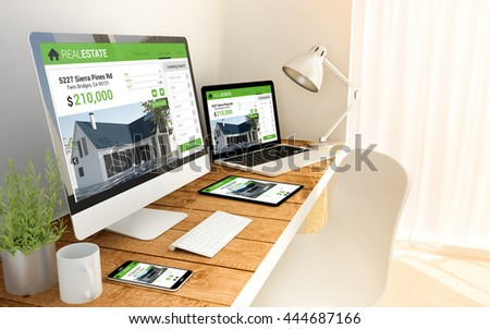 Digital generated devices over a wooden table with real estate responsive website. All screen graphics are made up.  - stock photo