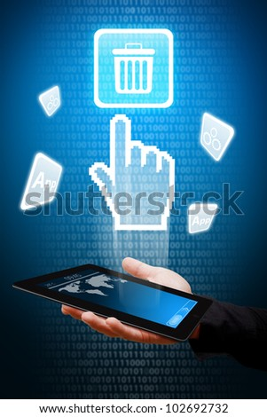 Digital hand touch the Bin icon from tablet computer - stock photo