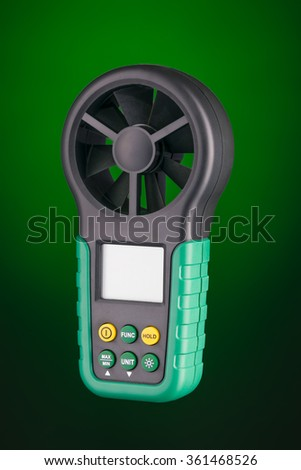 Digital handheld anemometer 3/4 view  isolated on green background