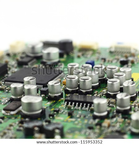 Digital hardware closeup. Microchips and condensers assembly on the circuit board macro - stock photo