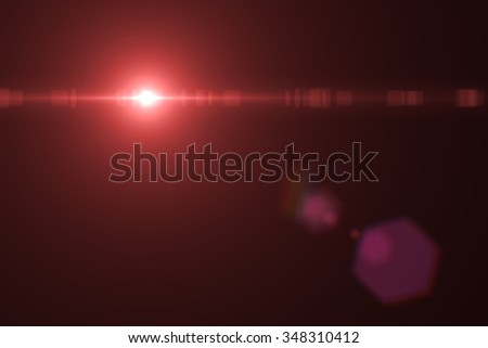 digital lens flare in black background horizontal frame warm - stock photo