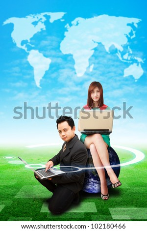 Digital man and lady on globe watching the world map on the sky : Elements of this image furnished by NASA - stock photo