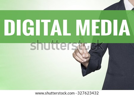 Digital Media word on green virtual screen touching by business woman - stock photo