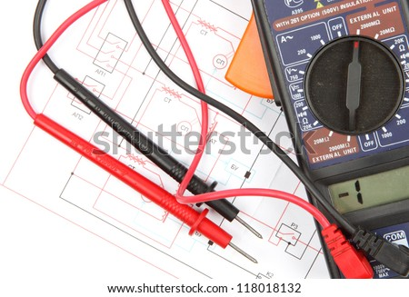 Digital multimeter and electronic circuitry - stock photo