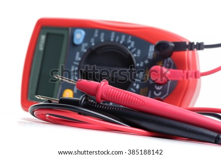digital multimeter or multitester or Volt-Ohm meter (closeup at test leads), an electronic measuring instrument that combines several measurement functions in one unit.