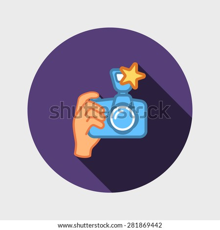 digital photo camera in hand - stock photo
