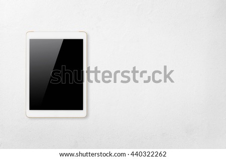 Digital tablet computer with isolated screen with clipping path on white concrete background.  - stock photo