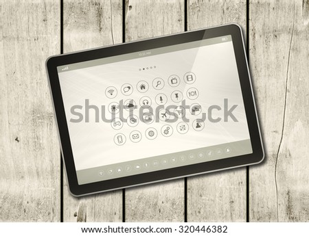 Digital tablet PC with desktop icons on a white wood table - horizontal office mockup - stock photo