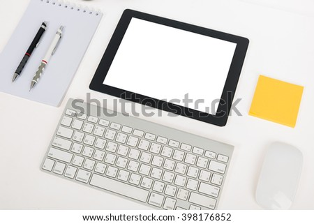Digital tablet touch pad computer with keyboard, mouse in office table business