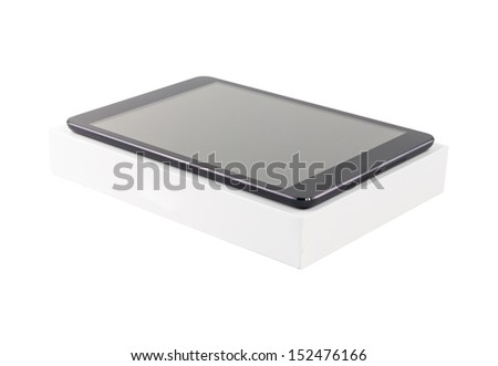 Digital tablet with its box on white background. Isolated. - stock photo