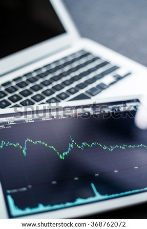 Digital tablet with stock market data - stock photo