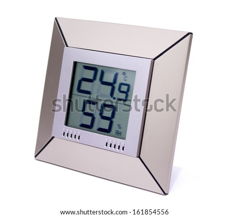Digital thermometer and humidity meter - stock photo