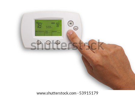 Digital Thermostat with a male hand, set to 78 degrees Fahrenheit. Saved with clipping path for thermostat and hand combined, isolated on white background - stock photo