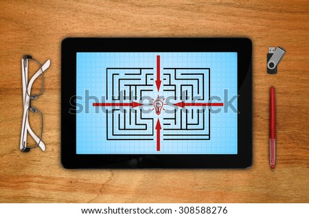 digital touch pad with maze on screen - stock photo