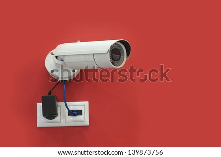 Digital video surveillance on a red background