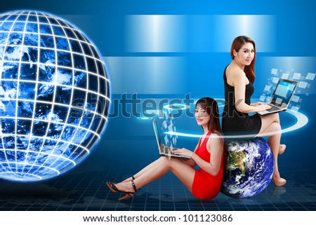 Digital world and Lady use computer : Elements of this image furnished by NASA - stock photo