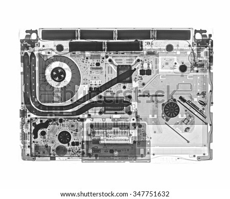 Digital X-ray image of notebook computer, black and white.