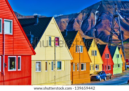 Digitally enhanced row of very colorful homes in Longyearbyen, Svalbard, Norway. - stock photo
