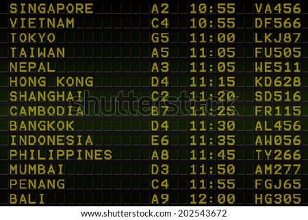 Digitally generated black airport departures board for asia