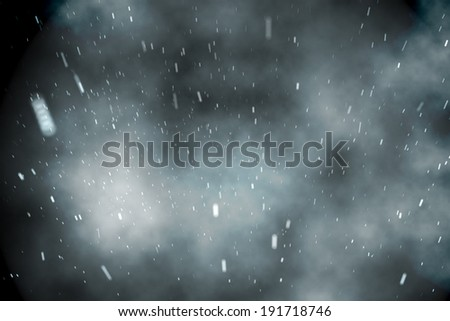 Digitally generated cloudy sky with snow falling