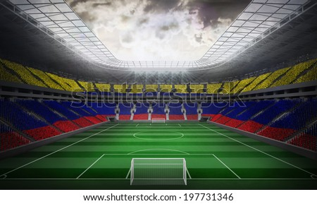 Digitally generated colombia national flag against football stadium