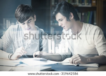 Digitally generated image of pie chart and bar graph against handsome student working on an essay - stock photo