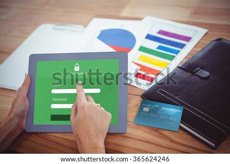 Digitally generated image of world credit card against over shoulder view of hipster woman using tablet - stock photo